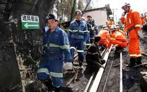 Rescuers make their way into the Xiahaizi mine shaft.