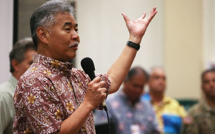 Hawaii Governor David Ige speaks at a community meeting in the aftermath of eruptions from the Kilauea volcano on Hawaii's Big Island