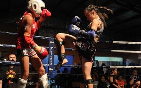 Emma Nesbitt, right, competing in Muay Thai kickboxing.