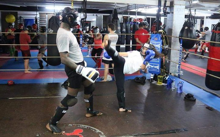 Emma Nesbitt sparring with NZ UFC star Israel Adesanya.