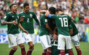 Hirving Lozano (covered) of Mexico celebrates his 0-1 goal with team mates.