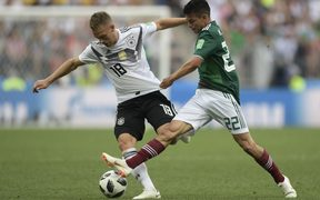 Germany's Joshua Kimmich (left) and Mexico's Hirving Lozano compete for the ball.