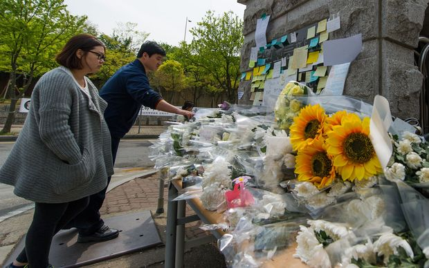 Flowers and messages have been left at the gates of Danwon high school.