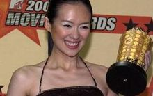 Taiwanese actress Zhang Zihi poses with her award for the first  Crouching Tiger, Hidden Dragon film.