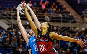 Tactix keeper Temalisi Fakahokotau and Steel shooter Jennifer O'Connell battle for possession.