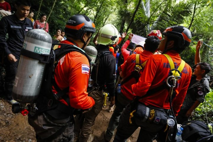 Thai rescue personnel arrive at the Tham Luang cave to conduct operations to find the missing members of the children's football team in a cave chamber along with their coach at the cave in Khun Nam Nang Non Forest Park in Chiang Rai.