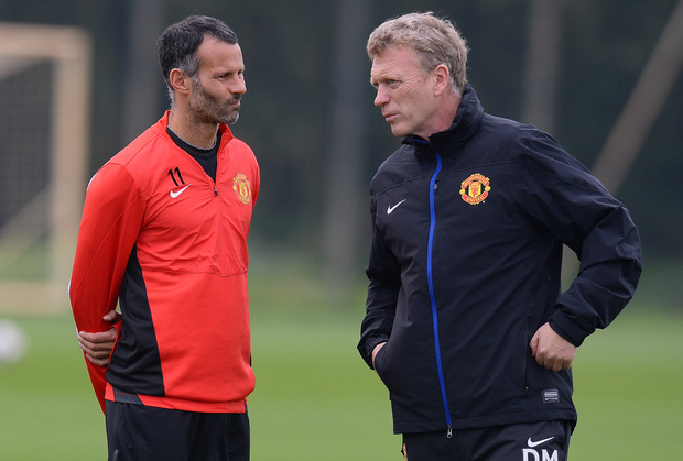 In happier times, Manchester United manager David Moyes (R) speaks to  midfielder Ryan Giggs .. the man who has temporarily replaced him.