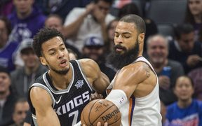 The Sacramento Kings' Skal Labissiere  is defended by the Phoenix Suns' Tyson Chandler.