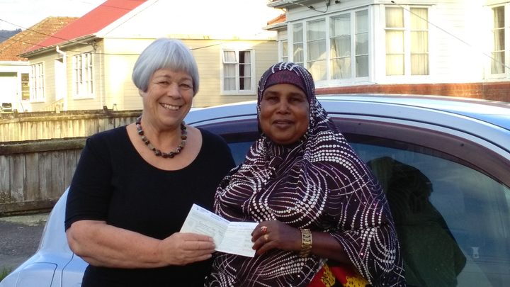volunteer Janet (left) and driver Suldano (right) after Suldano passed her test.