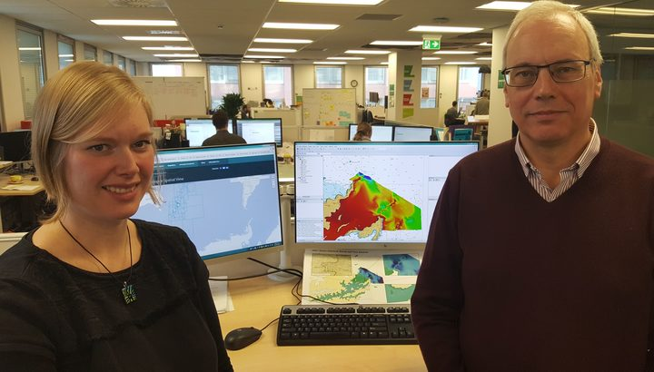 Hydrographers Annette Wilkinson and Adam Greenland. The coloured image on the computer screen is an electronic chart of the sea floor.