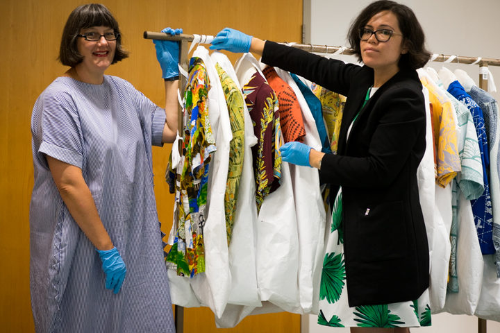 Claire Regnault and Sonya Withers with Te Papa's collection of Aloha Shirts