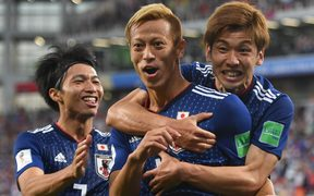 Japan's football team reach the last 16 at the FIFA World Cup after a yellow card countback.