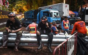 Technicians and engineers rest at one of the water pumping sites near the Tham Luang cave at the Khun Nam Nang Non Forest Park in Chiang Rai province as the rescue operation continues for a missing children's football team and their coach.