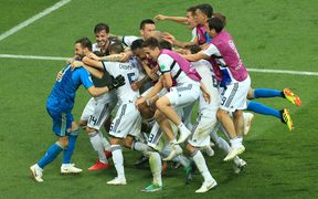 Russian players mob goalkeeper Igor Akinfeev after he saves the final penalty and wins them the match.