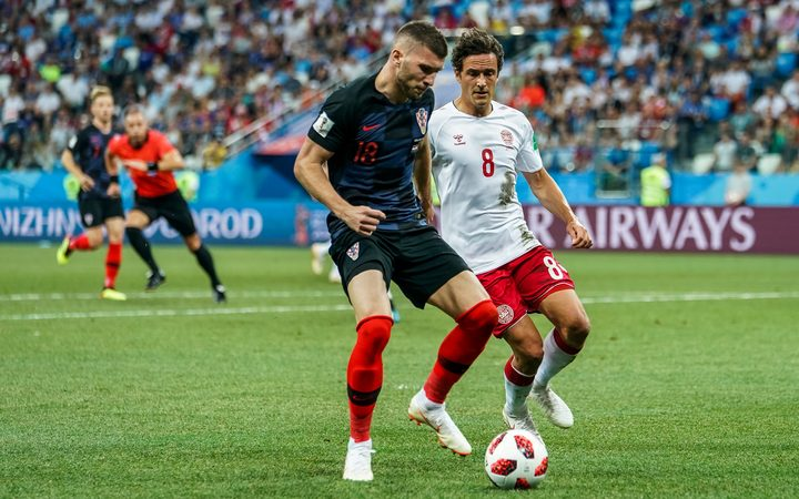 Ante Rebic of Croatia about to be challenged by Thomas Delaney of Denmark