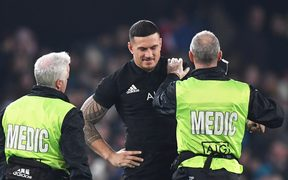 Medical staff check out Sonny Bill Williams injured shoulder.