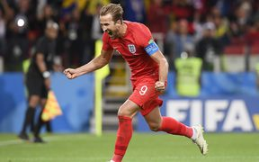 England captain Harry Kane celebrates scoring a goal against Colombia at the Football World Cup in Russia.
