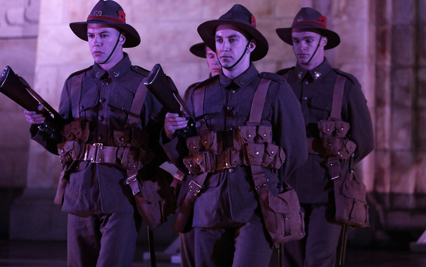 250414. Photo Diego Opatowski / RNZ. Troops in World War I uniforms marching on the Cenotaph in Wellington.