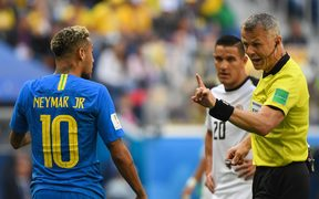 Brazilian star Neymar is warned by the referee to be quiet.