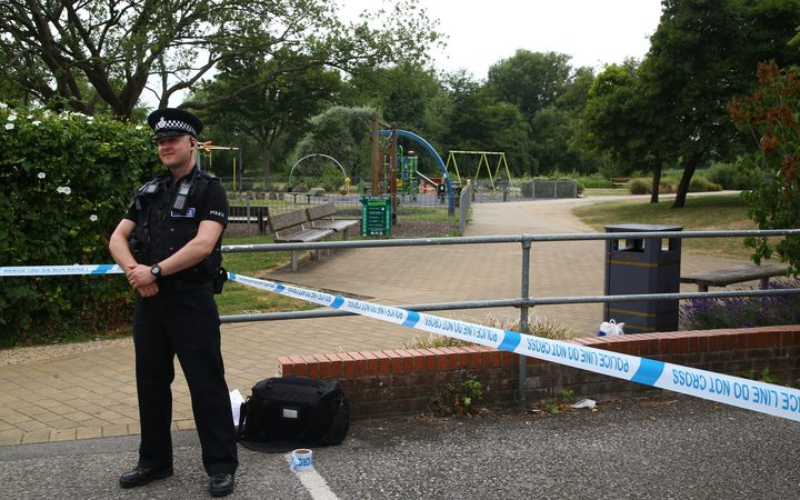 A police officer stands at a cordon at Queen Elizabeth Gardens in Salisbury