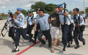Matt Lockley being arrested by Indonesian Air Force soldiers.