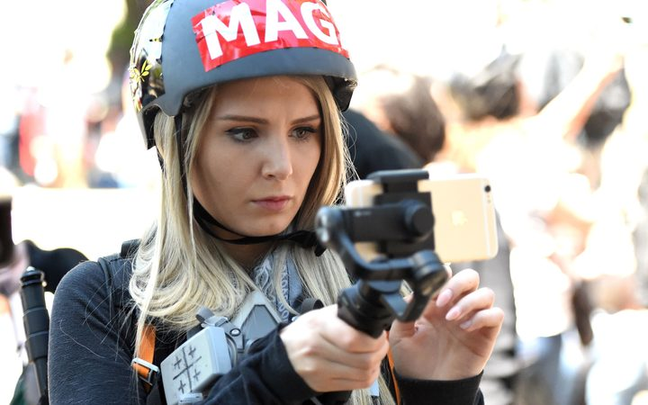 Canadian conservative and libertarian activist Lauren Southern live streams a video during a rally in Berkeley in April 2017.