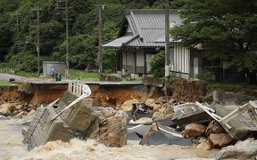 This picture shows a collapsed road due to heavy rain in Higashihiroshima, Hiroshima prefecture on July 7, 2018.