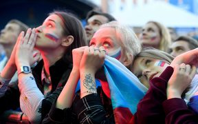 Russian fans watch the quarter-final football match between Russia and Croatia on a giant screen in Saint Petersburg on July 7, 2018 during the Russia 2018 football World Cup.