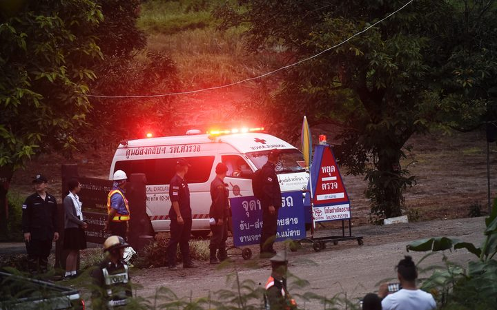 An ambulance leaves the Tham Luang cave area.