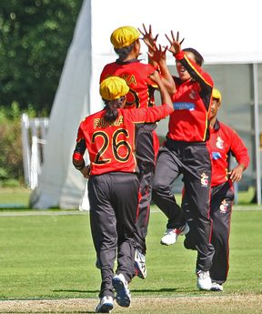 PNG celebrate a wicket against UAE at the World T20 Qualifiers.
