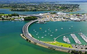 An aerial view of Tauranga with the Harbour Bridge in the foreground.