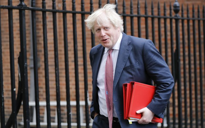 Boris Johnson blasted for posing for resignation photos