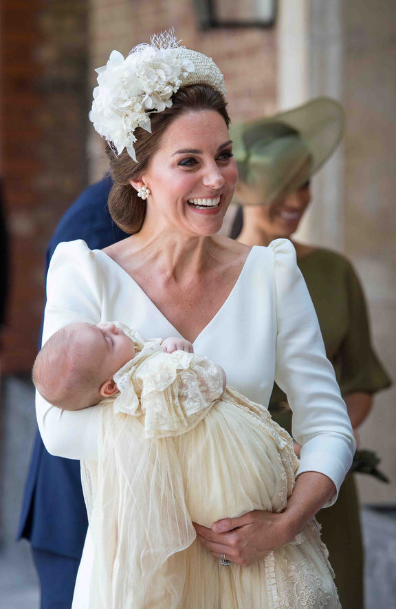 Britain's Catherine, Duchess of Cambridge holds Britain's Prince Louis of Cambridge on their arrival for his christening service.