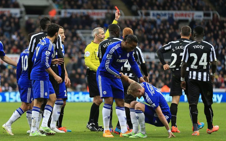 Steven Taylor is sent off while playing for Newcastle United against Chelsea in the English premier league in 2014.