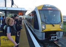 Commuters at Onehunga station as new electric trains start their regular runs.