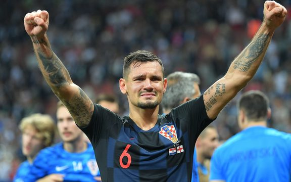 Croatia's Dejan Lovren celebrates his team's 2-1 victory at the World Cup semifinal soccer match against England.