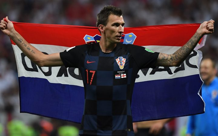 Croatian forward Mario Mandzukic celebrates at the end of the Russia 2018 World Cup semi-final football match against England.