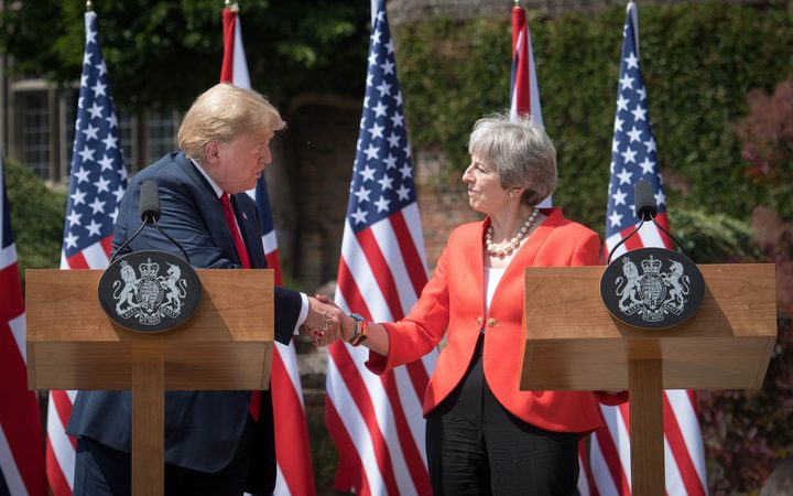 US President Donald Trump and Britain's Prime Minister Theresa May shake hands during a press conference following their meeting at Chequers, the prime minister's country residence, near Ellesborough, northwest of London on the second day of Trump's UK visit.