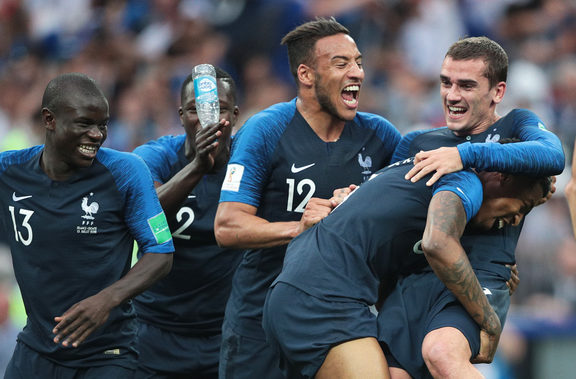 France's players celebrate their team's 4-2 victory in the World Cup final soccer match.