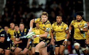 Jordie Barrett and Ardie Savea playing for Hurricanes against Highlanders