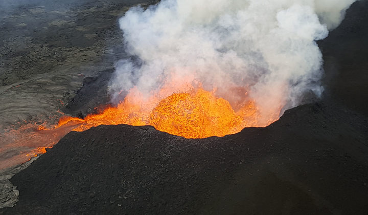 Kilauea Volcano, Hawaii, on 18 June.The image was obtained from the US Geological Survey and shows a view of Fissure 8  lava fountain as it pulses to heights of 50 m (165 ft) within a cinder spatter cone.