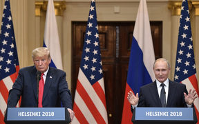 Russian President Vladimir Putin and US President Donald Trump, left, during the joint news conference following their meeting in Helsinki.