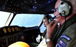 RNZAF Squadron Leader Brett McKenzie (left) and Flight Engineer Trent Wyatt aboard an Orion during the search.