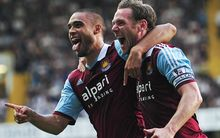West Ham United's New Zealand defender Winston Reid (L) and midfielder Kevin Nolan (R)
