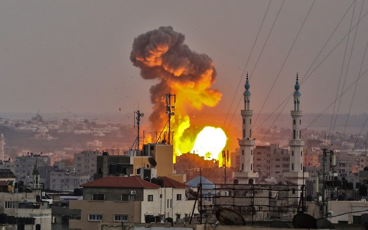 A fireball exploding in Gaza City during Israeli bombardment.