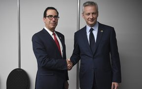 French Finance and Economy Minister Bruno Le Maire (R) shakes hands with US Secretary of the Treasury Steven Mnuchin during a bilateral meeting in Buenos Aires, on July 21, 2018, in the framework of the G20 meeting.