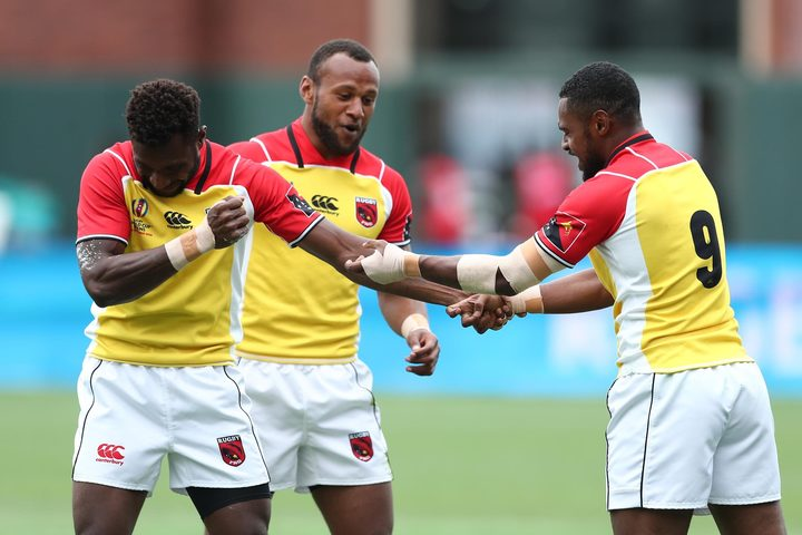 Papua New Guinea players celebrate a try against Jamaica.