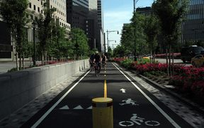 A group of cyclists ride along a dedicated bike lane in downtown Manhattan on May 29, 2016 in New York.
