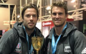 New Zealand Sevens co-captains Tim Mikkelson and Scott Curry with the world cup.