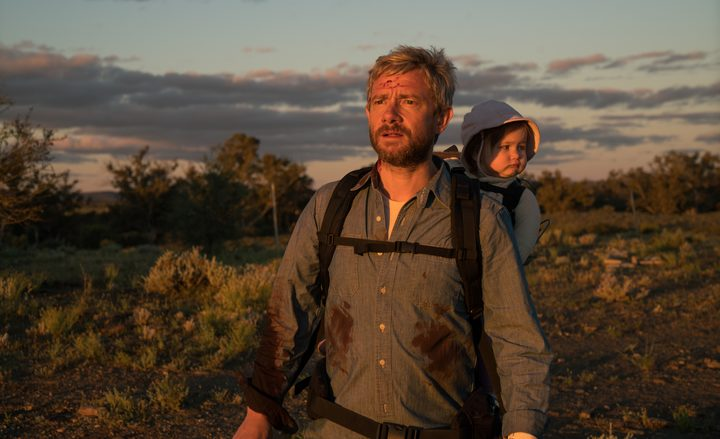 Martin Freeman and one of the two sets of twins who plays his daughter Rosie in Cargo.
